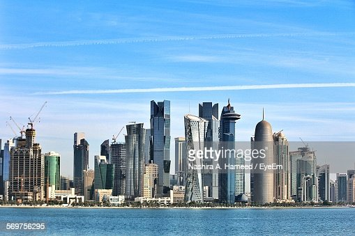 Sea Against Doha Tower And Modern Buildings In City