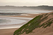 Sea and sand dunes and coastal forest of Maitlands beach, Port Elizabeth, Eastern Cape, South Africa.