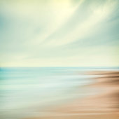 A seascape abstract with panning motion combined with a long exposure.  Image displays soft, pastel colors in a retro style.