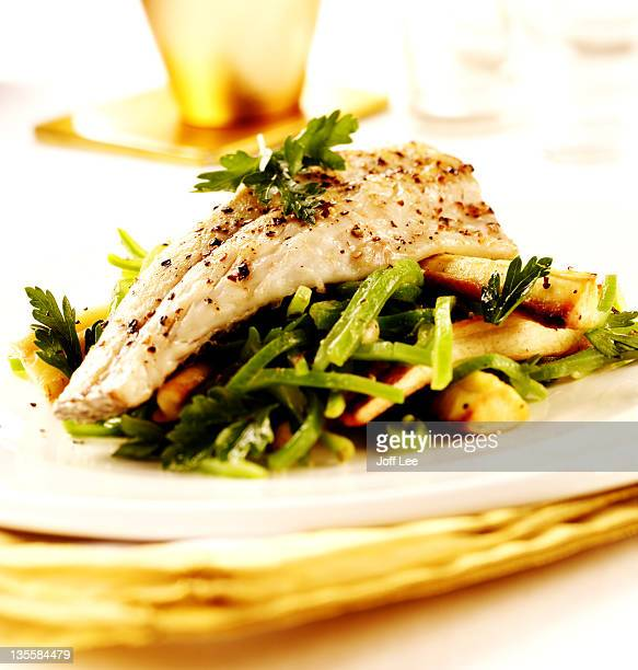 Sea bass on a bed of vegetables