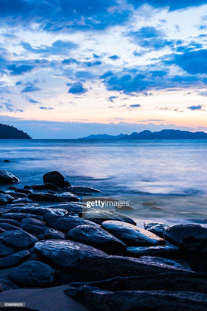 Sea beach with rocks on slow shutter speed : Stock Photo