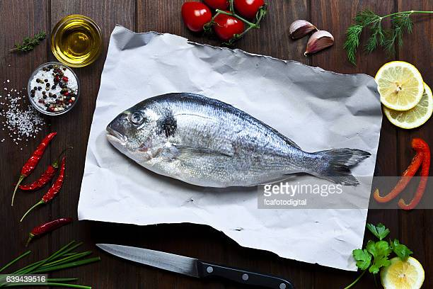 Sea bream and ingredients for cooking and seasoning