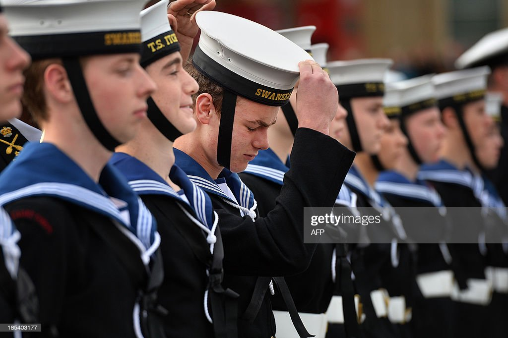 A Sea Cadet adjusts his hat as he takes part in a parade in London's Trafalgar Square on October 20, 2013, to mark the anniversary of the Battle of Trafalgar. The Battle of Trafalgar was fought on October 21, 1805.