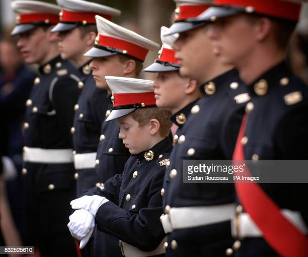 A Sea Cadet checks the time as he prepares to take part in this year's annual Trafalger Day commemorations in London's Trafalger Square where they...