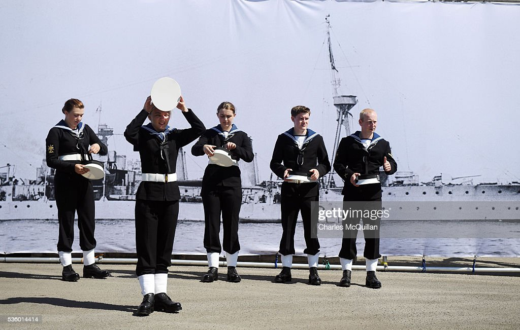 Sea Cadets prepare for a service at HMS Caroline in front of a banner of the ship on May 31, 2016 in Belfast, Northern Ireland. HMS Caroline is the last surviving ship from the 1916 Battle of Jutland and today hosted a special all island commemoration service ahead of it's reopening to the public tomorrow after a major restoration project. The Battle of Jutland is remembered as the largest and deadliest naval battle of World War One, where more than 6,000 British and more than 2,500 German personnel lost their lives in the 36-hour Battle off the coast of Denmark.