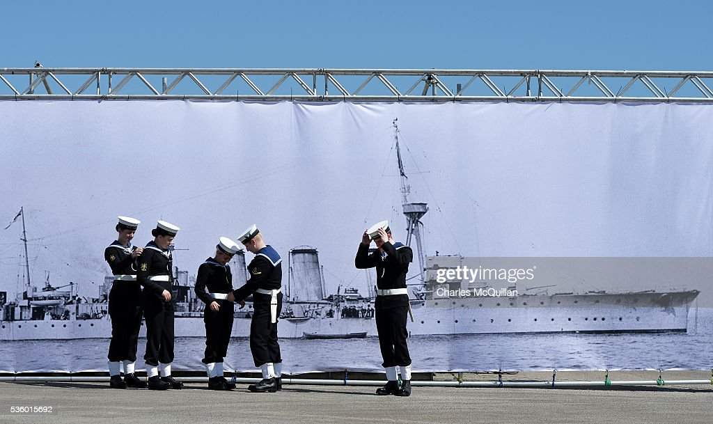 Sea Cadets prepare for a service at HMS Caroline in front of a banner of the ship on May 31, 2016 in Belfast, Northern Ireland.HMS Caroline is the last surviving ship from the 1916 Battle of Jutland and today hosted a special all island commemoration service ahead of it's reopening to the public tomorrow after a major restoration project. The Battle of Jutland is remembered as the largest and deadliest naval battle of World War One, where more than 6,000 British and more than 2,500 German personnel lost their lives in the 36-hour Battle off the coast of Denmark.