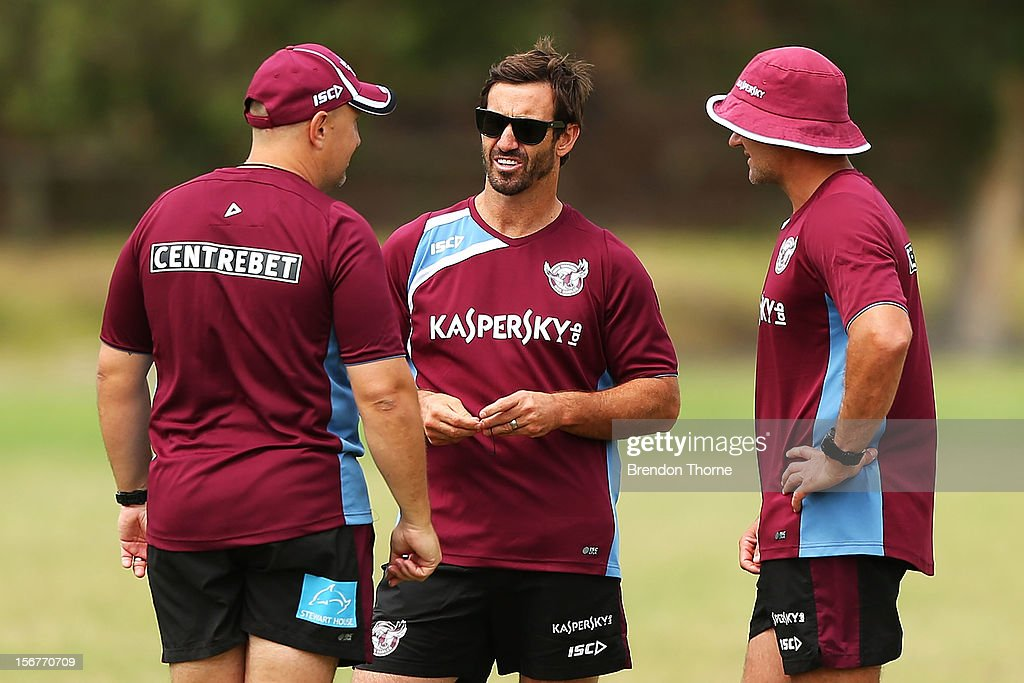 Sea Eagles assistant coach Andrew Johns speaks with coaching staff during a Manly Sea Eagles NRL pre-season training session at Sydney Academy of Sport on November 21, 2012 in Sydney, Australia.
