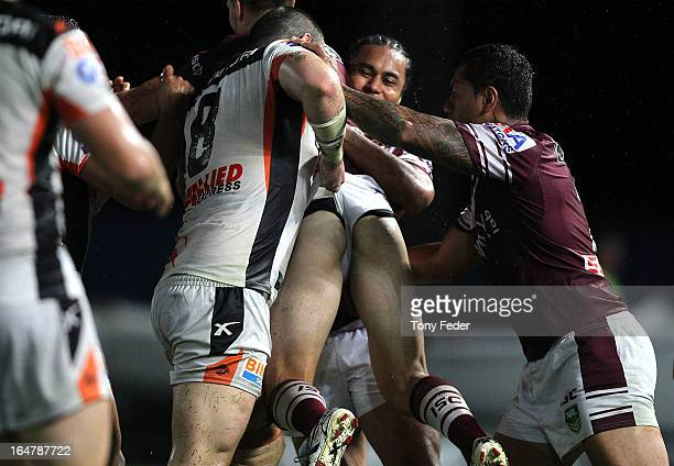Sea Eagles player has his shorts pulled by Aaron Woods of the Wests Tigers during the round four NRL match between the Manly Sea Eagles and the Wests...