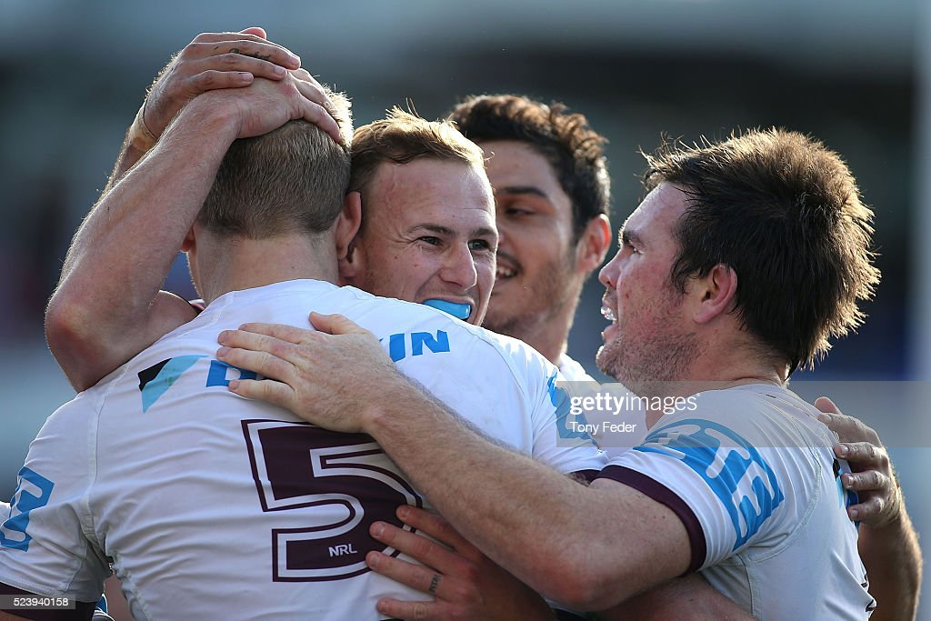 Sea Eagles players celebrate a try during the round eight NRL match between the Newcastle Knights and the Manly Sea Eagles at Hunter Stadium on April 25, 2016 in Newcastle, Australia.