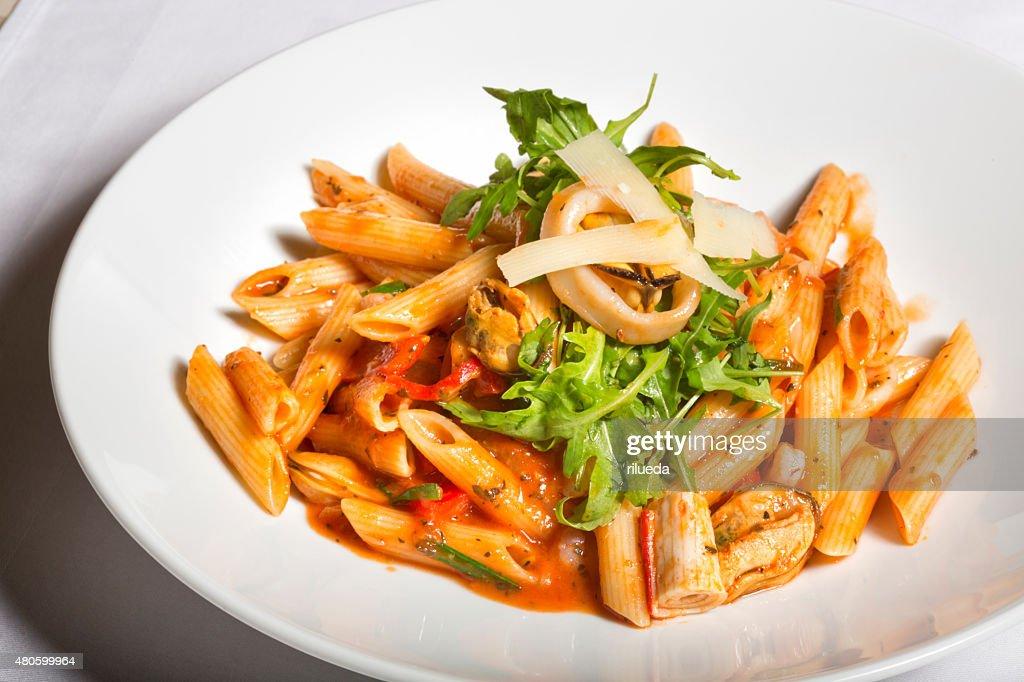 Sea food and tomato sauce pasta : Stock Photo