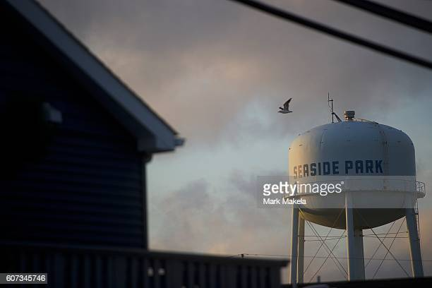 A sea gull flies past a labeled water tower less than a half mile away from the scene of an 'pipe bombstyle device' explosion on September 17 2016 in...