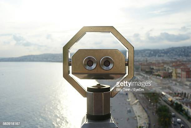 Sea In Front Of Coin-Operated Binocular Against Sky