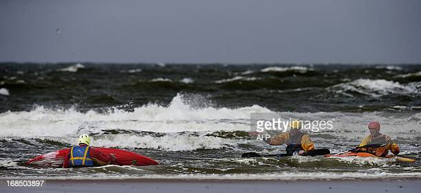 Sea kayakers enjoy the strong southwest wind at a beach in Maasvlakte the Netherlands on May 10 2013 In the coming days the nice weather will be...