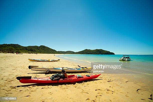 Sea kayaks on a beach of Abel Tasman park