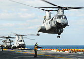 A CH-46E Sea Knight helicopter takes off from the flight deck of USS Essex.
