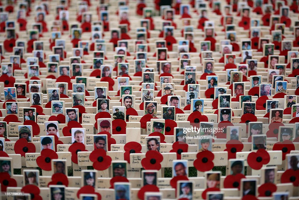 A sea of crosses bearing pictures of soldiers killed in Afghanistan is placed in the Royal British Legion Field of Remembrance at Westminster Abbey on November 8, 2012 in London, England. Hundreds of small crosses bearing a poppy have been planted in a Field of Remembrance in a tribute to British servicemen and women who have lost their lives in conflict.