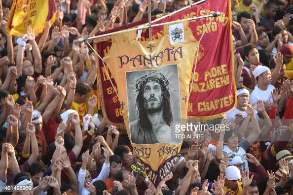 Sea of devotees raise their hands as they attend mass during the annual religious procession in honor of the Black Nazarene in Manila on January 9...