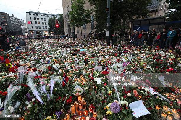 A sea of flowers and candles are left outside Oslo Cathedral following Friday's twin extremist attacks Anders Behring Breivik claimed that he has...
