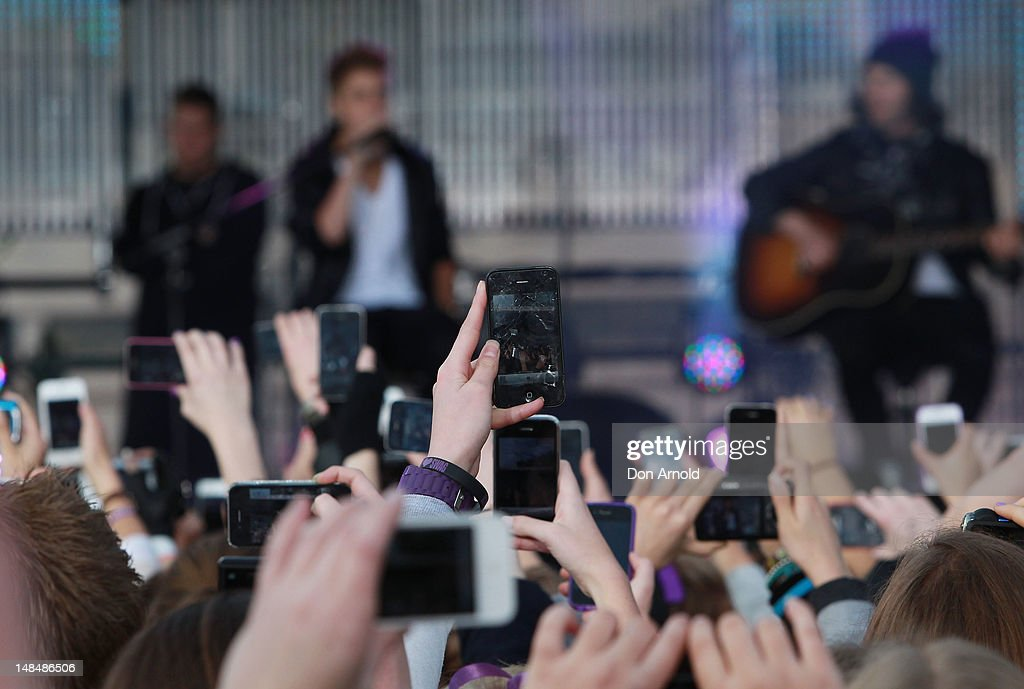 A sea of mobile phone cameras capture <a gi-track='captionPersonalityLinkClicked' href=/galleries/search?phrase=Justin+Bieber&family=editorial&specificpeople=5780923 ng-click='$event.stopPropagation()'>Justin Bieber</a> as he performs live on the Sunrise program at The Overseas Passenger Terminal on July 18, 2012 in Sydney, Australia.