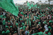 A sea of Palestinain Hamas supporters cheer during a celebration rally in the southern Gaza Strip refugee camp of Khan Yunes 27 January 2006 after...