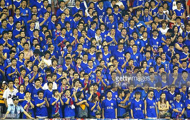 A sea of supporters for the Shanghai Shenhua SVA encourage their favorite players on a grandstand during the match in China's soccer Division A...