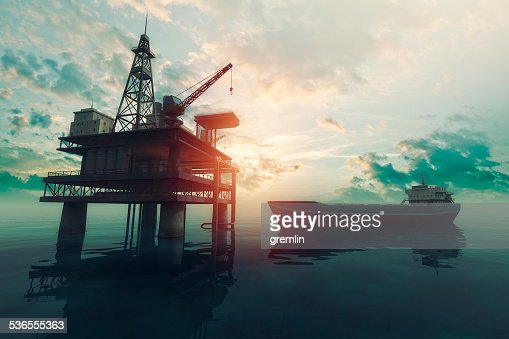Sea oil rig with approaching tanker ship at sunset