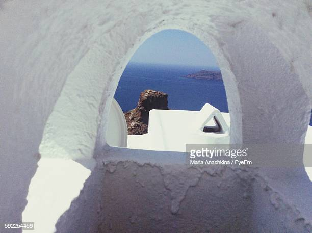 Sea Seen Through Arch Window In Santorini