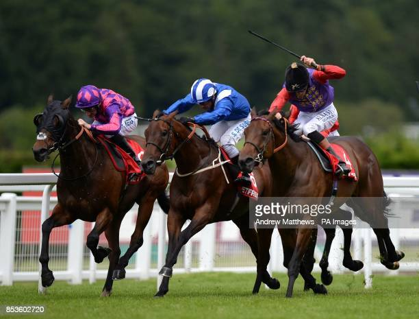 Sea Shanty ridden by jockey Richard Hughes goes on to win the Betfred 'double Delight' Handicap ahead of Tanseeb ridden by Silvestre De Sousa and St...