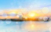 Sea shore sunset blurred view background.Vocation concept backdrop.Horizon coast defocused illustration.