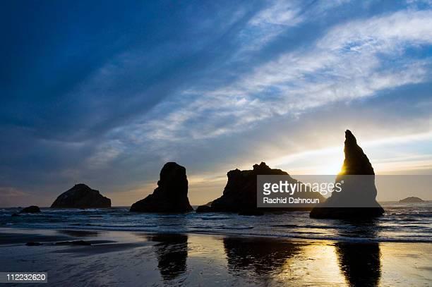 Sea stacks at sunset on Bandon Beach on the Oregon coast.