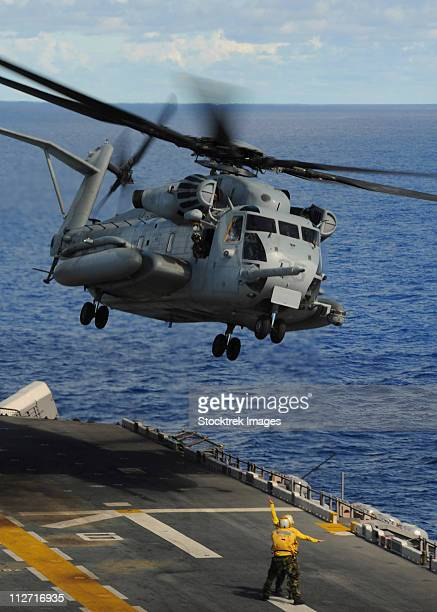 A CH-53E Sea Stallion helicopter takes off from amphibious assault ship USS Essex.