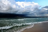 Storm clouds over the sea and pier at Pensacola Beach, Florida
