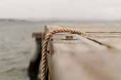sea view from a pontoon with focus on a rope