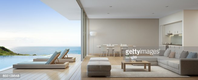 Sea view kitchen, dining and living room of luxury beach house with terrace near swimming pool in modern design. Vacation home or holiday villa for big family. : Stock Photo