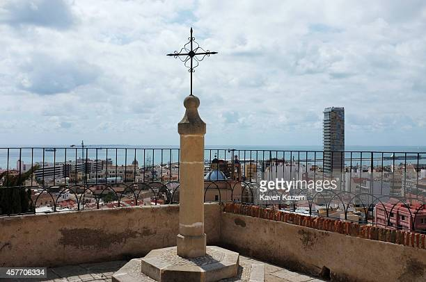 A sea view with cityscape seen from the old city where a cross is erected on the hilltop on August 17 2014 in Alicante Spain
