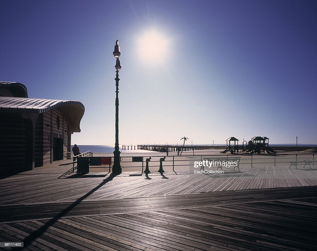 Sea view with morning sunlight hitting boardwalk. : Stock Photo