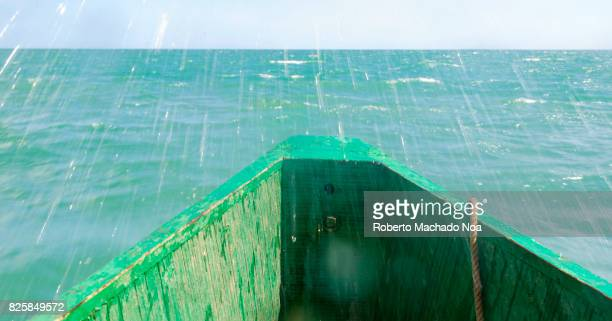 Sea water entering boat as moves against the Caribbean sea waves Clear light blue water of the tropical climate