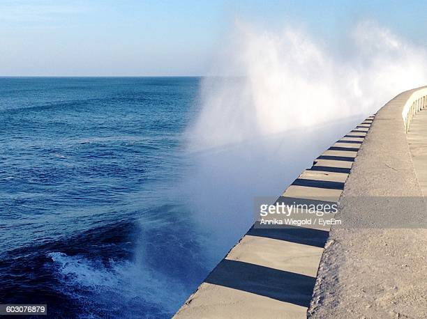 Sea Water Splashing On Retaining Wall