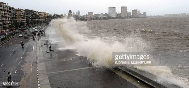 Sea waves lash the Marine Drive promenade on the Arabian Sea front in Mumbai on July 23 2009 The civic authorities of India's commercial and...