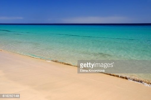 Sea with crystal water and golden sand on the beach. : Stock Photo