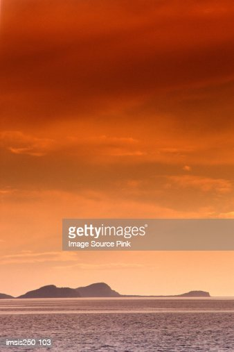 Sea with mountains in the backgound : Stock Photo
