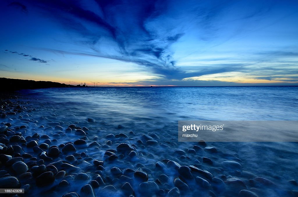 Sea with small rocks : Stock Photo