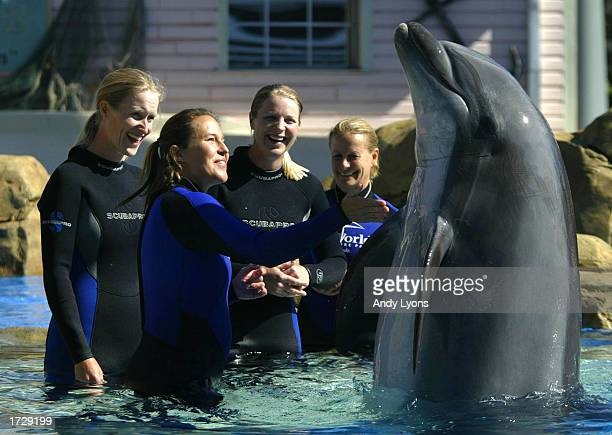 Sea World trainer Julie Fisher shows LPGA Tour players Janice Moodie and Charlotta Sorenstam how to shake with a dolphin during the Trainer for a Day...