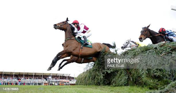 Seabass ridden by Katie Walsh leads at the final fence before losing to Neptune Collonges ridden by Daryl Jacob during the Grand National horse race...