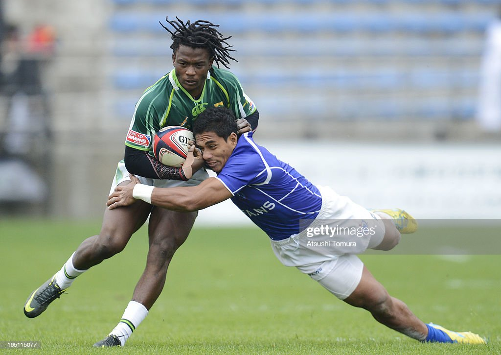 Seabelo enatla of South Africa tries to break a tackle during the match against Samoa on day two of the HSBC Sevens Tokyo at Prince Chichibu Stadium on March 31, 2013 in Tokyo, Japan.