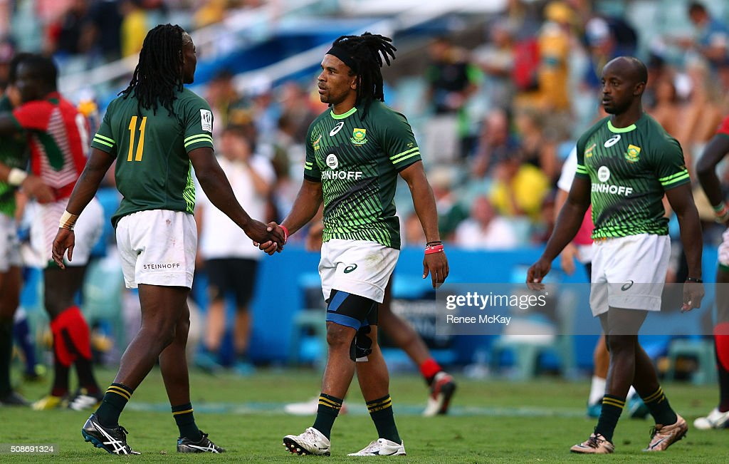 Seabelo Senatla and Rosko Specman of South Africa celebrate their win after the day 1 match between South Africa and Kenya at the HSBC Sydney Sevens at Allianz Stadium on February 06, 2016 in Sydney, Australia.