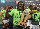 Seabelo Senatla holds the trophy during day 2 in the Final between South Africa and New Zealand of the Cell C Nelson Mandela Bay Sevens Series at...