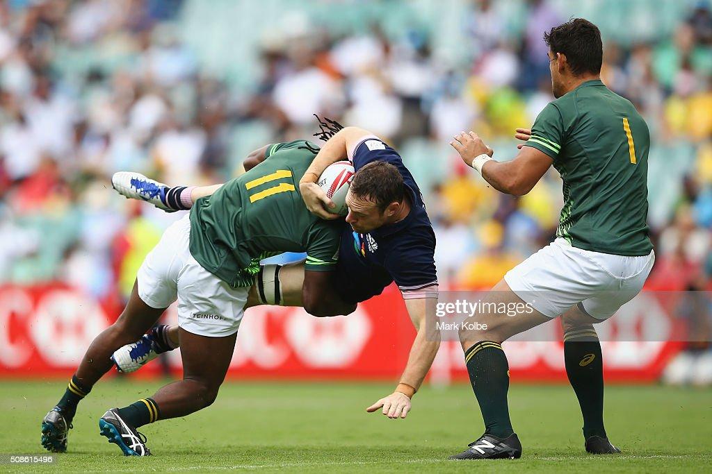 Seabelo Senatla of South Africa tackles Scott Riddell of Scotland during the 2016 Sydney Sevens match between South Africa and Scotland at Allianz Stadium on February 6, 2016 in Sydney, Australia.