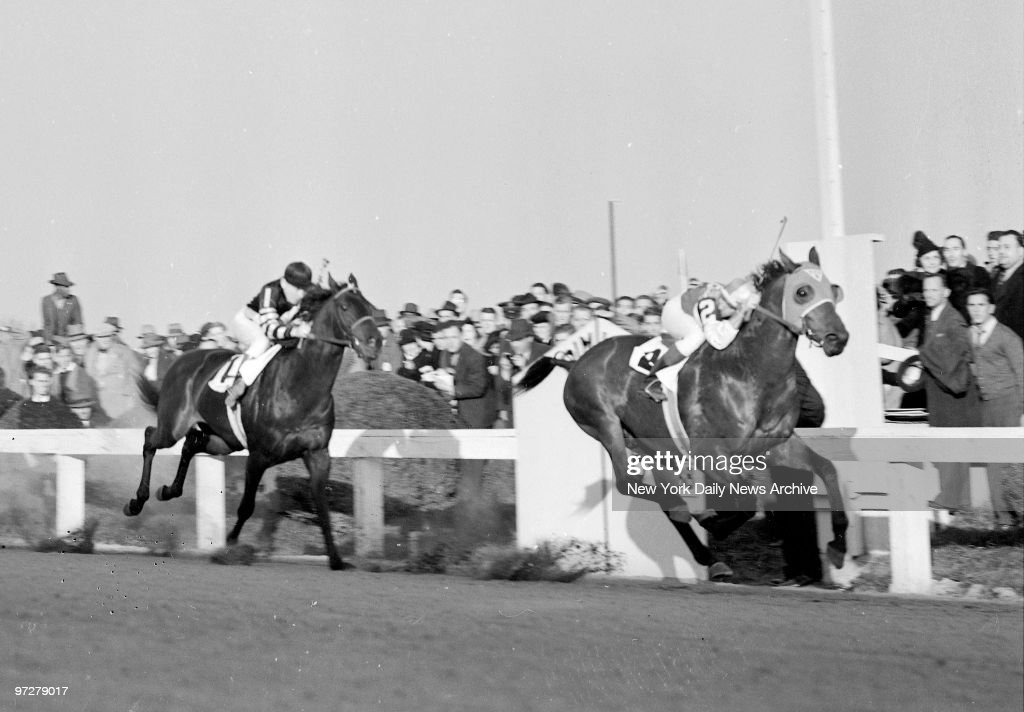 Seabiscuit beats War Admiral at Pimlico