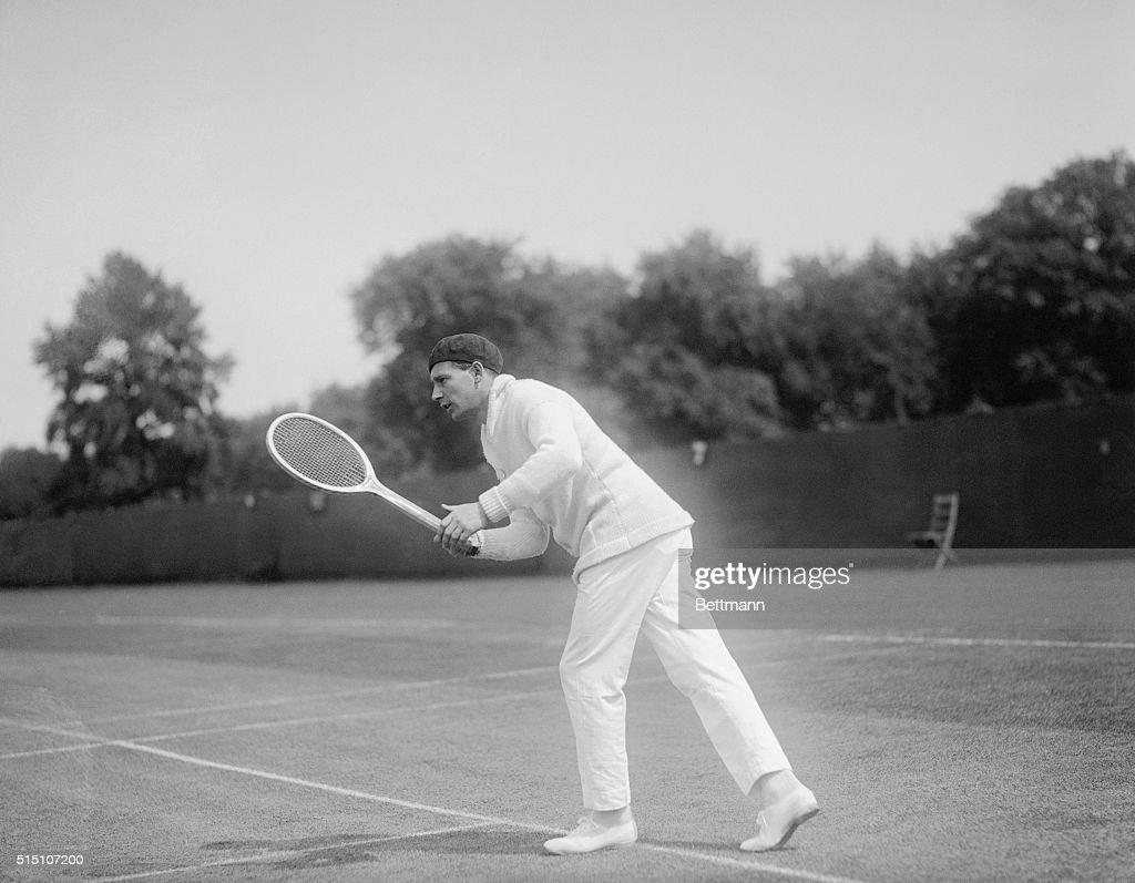 Jean Borotra Holding a Tennis Racquet